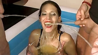 sexy video: Brunette drinking and swallowing urinei